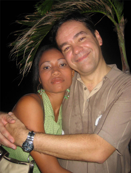 A photo of a smiling client hugging a Colombian woman